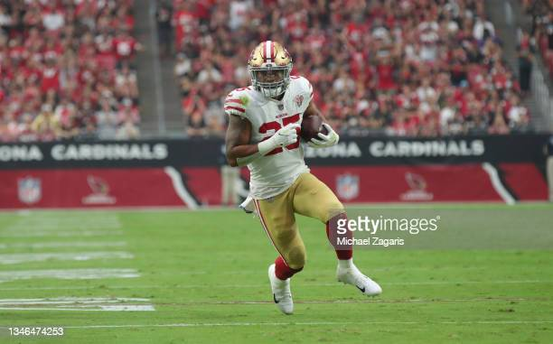 Elijah Mitchell of the San Francisco 49ers runs after making a catch during the game against the Arizona Cardinals at State Farm Stadium on October...