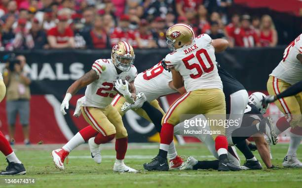 Elijah Mitchell of the San Francisco 49ers rushes during the game against the Arizona Cardinals at State Farm Stadium on October 10, 2021 in...