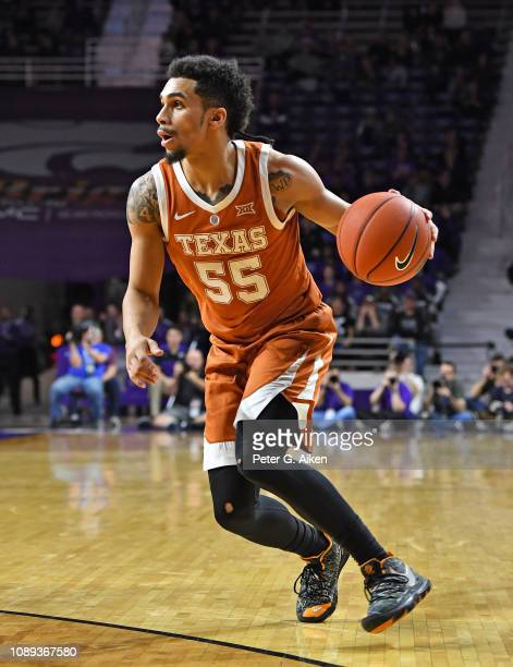 Elijah MitrouLong of the Texas Longhorns dribbles the ball up court against the Kansas State Wildcats during the first half on January 2 2019 at...