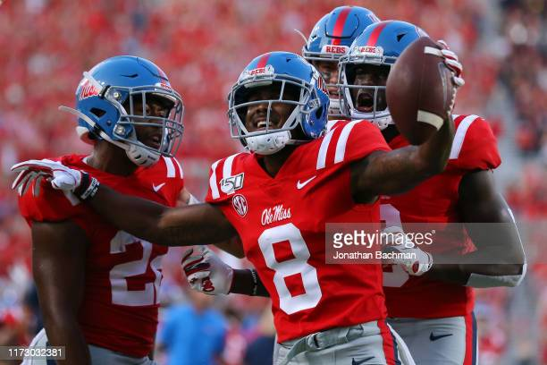 Elijah Moore of the Mississippi Rebels celebrates a touchdown during the first half against the Arkansas Razorbacks of a game at Vaught-Hemingway...