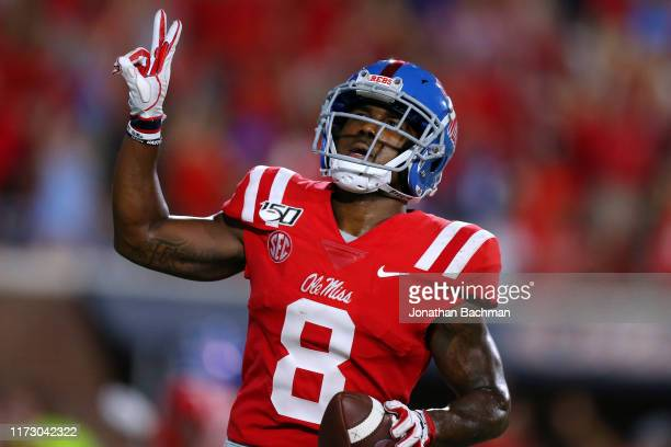 Elijah Moore of the Mississippi Rebels celebrates a touchdown during the second half of a game against the Arkansas Razorbacks at VaughtHemingway...