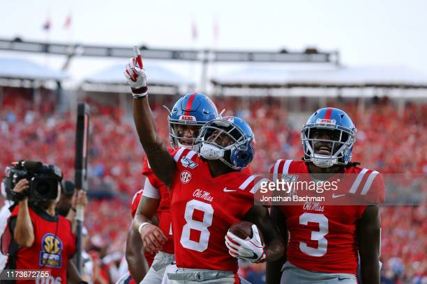 Elijah Moore of the Mississippi Rebels celebrates a touchdown during the first half against the Arkansas Razorbacks of a game at VaughtHemingway...
