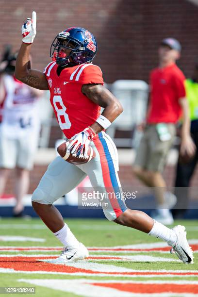 Elijah Moore of the Mississippi Rebels celebrates after scoring a touchdown against the Southern Illinois Salukis during the first half at...