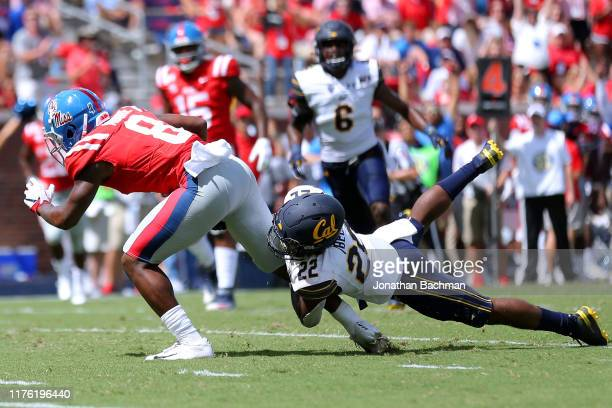 Elijah Moore of the Mississippi Rebels is tackled by Traveon Beck of the California Golden Bears during the second half of a game at VaughtHemingway...