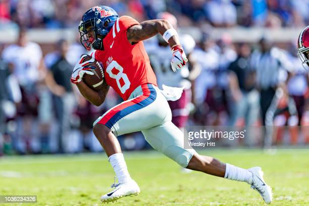 Elijah Moore of the Mississippi Rebels runs the ball for a touchdown during a game against the Southern Illinois Salukis at VaughtHemingway Stadium...