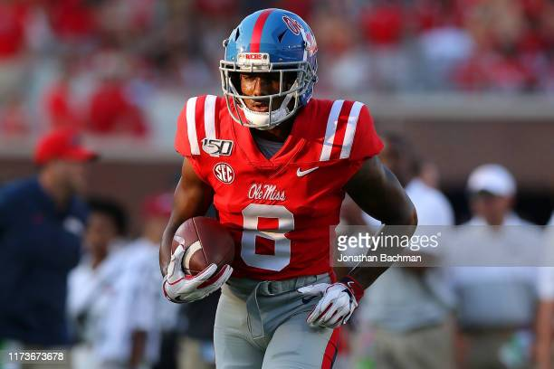 Elijah Moore of the Mississippi Rebels runs with the ball during a game against the Arkansas Razorbacks at VaughtHemingway Stadium on September 07...