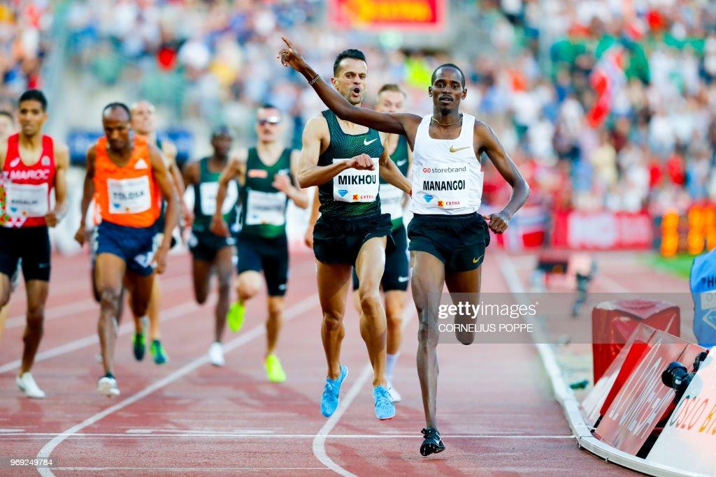 Elijah Motonei Manangoi from Kenya (R) celebrates winning ahead Sadik Mikhou from Bahrain in the 1 Mile Men, Dream Mile at the IAAF Diamond League 2018 Bislett Games on June 7, 2018 at Bislett Stadium in Oslo, Norway. (Photo by Cornelius POPPE / NTB Scanpix / AFP) / Norway OUT