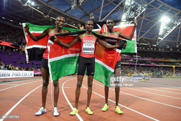 Elijah Motonei Manangoi of Kenya is congratulated by Timothy Cheruiyot and Asbel Kiprop of Kenya after the Men's 1500 metres final during day ten of...