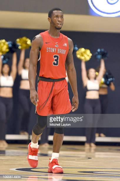 Elijah Olaniyi of the Stony Brook Seawolves looks on during a college basketball game against the George Washington Colonials at the Smith Center on...
