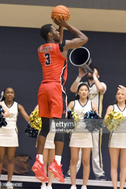Elijah Olaniyi of the Stony Brook Seawolves takes a jump shot during a college basketball game against the George Washington Colonials at the Smith...