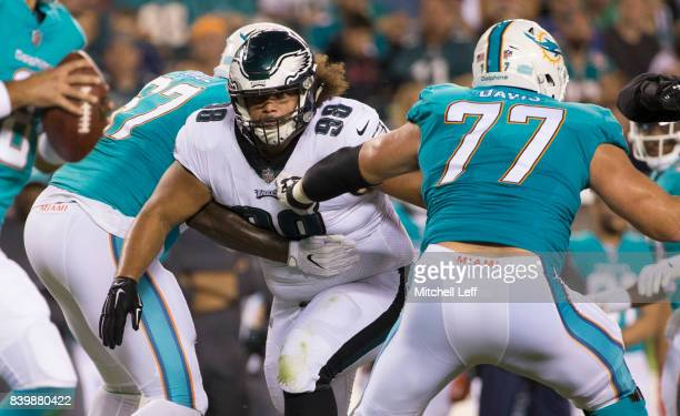 Elijah Qualls of the Philadelphia Eagles plays against Laremy Tunsil and Jesse Davis of the Miami Dolphins in the preseason game at Lincoln Financial...