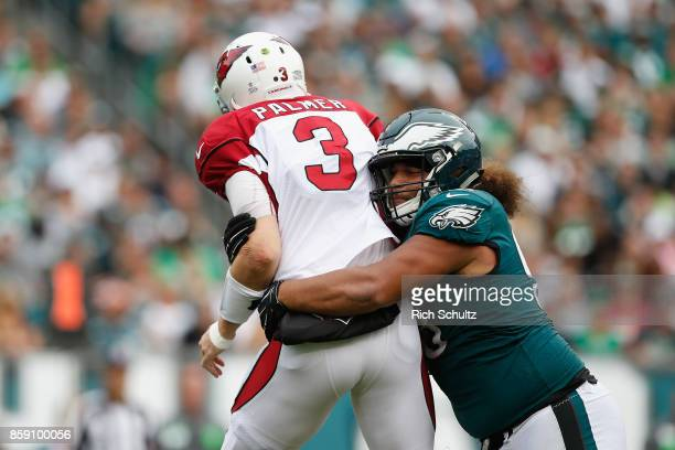 Elijah Qualls of the Philadelphia Eagles tackles quarterback Carson Palmer of the Arizona Cardinals during the second half at Lincoln Financial Field...