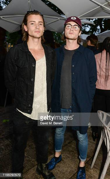 """Elijah Rowen and Jack McEvoy at Tanqueray No Ten preview party for the launch of """"Beyond the Road"""" at the Saatchi Gallery on June 11 2019 in London..."""