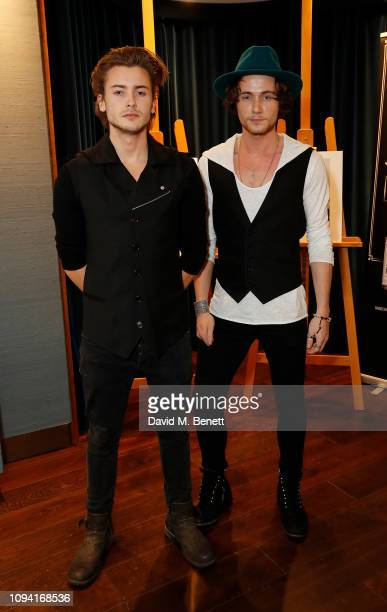 Elijah Rowen and Jack McEvoy attend an exhibition of photographs by British celebrity photographer Ray Burmiston raising funds for Variety The...