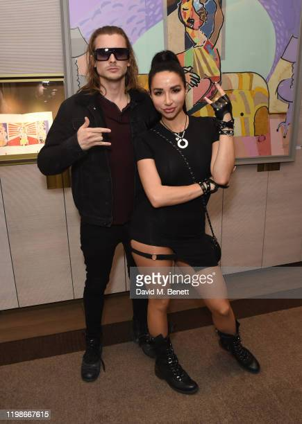 Elijah Rowen and Natasha Grano attend a private view of Olivier Mourao's new exhibition 'Painting With Paper' at Mount Gallery on February 4 2020 in...