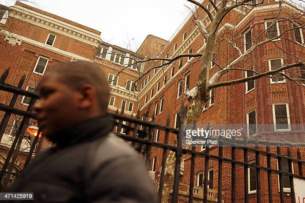 Elijah Salters stands in front of The Auburn Family Residence, a shelter for homeless families and individuals on February 21, 2014 in the Fort...