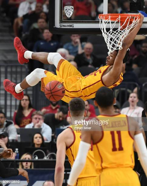 Elijah Stewart of the USC Trojans dunks against the Oregon Ducks during a semifinal game of the Pac12 basketball tournament at TMobile Arena on March...