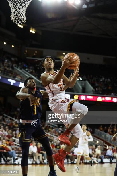 Elijah Stewart scores a layup against Darius McNeill of the California Golden Bears during a NCAA PAC12 college basketball game at Galen Center on...