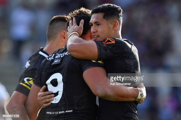 Elijah Taylor of the Kiwis is congratulated by Roger TuivasaSheck of the Kiwis after scoring a try during the 2017 Rugby League World Cup match...