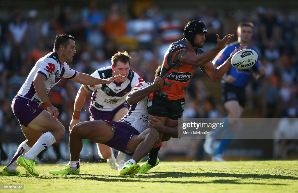 Elijah Taylor of the Tigers offloads during the round four NRL match between the Wests Tigers and the Melbourne Storm at Leichhardt Oval on March 26, 2017 in Sydney, Australia.