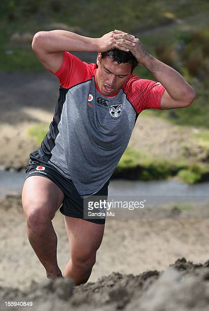 Elijah Taylor of the Warriors trains on the sand dunes during the New Zealand Warriors NRL training session at Bethells Beach on November 10 2012 in...