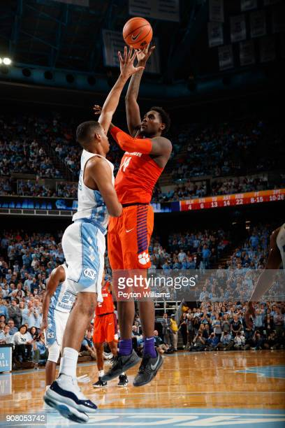 Elijah Thomas of the Clemson Tigers shoots the ball over Garrison Brooks of the North Carolina Tar Heels on January 16 2018 at the Dean Smith Center...