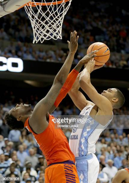 Elijah Thomas of the Clemson Tigers tries to stop Garrison Brooks of the North Carolina Tar Heels during their game at Dean Smith Center on January...