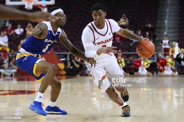 Elijah Weaver of the USC Trojans handles the ball against Taze Moore of the Cal State Bakersfield Roadrunners during a college basketball game at...