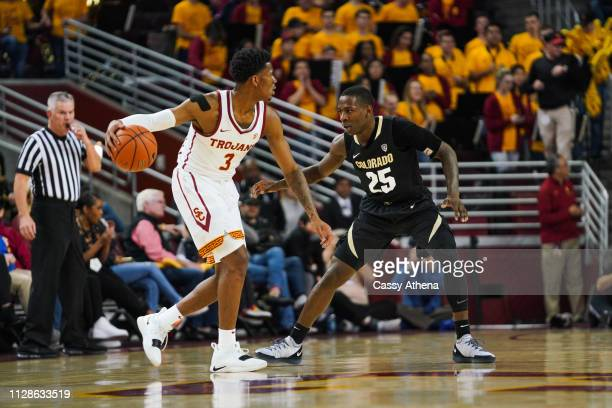 Elijah Weaver of the USC Trojans handles the ball in a game against McKinley Wright IV of the Colorado Buffaloes at Galen Center on February 09 2019...