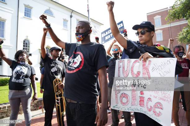 Elijah Whiteside, right, and Justin Hunt lead protestors calling for justice for Jamal Sutherland on May 17, 2021 in Charleston, South Carolina....