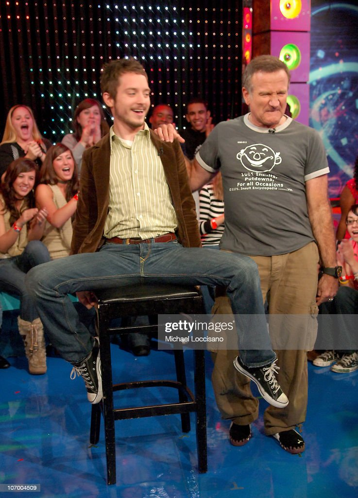 Elijah Wood and Robin Williams during Robin Williams, Elijah Wood, Snoop Dogg and Panic! At The Disco Visit MTV's 'TRL' - November 14, 2006 at MTV Studios - Times Square in New York City, New York, United States.