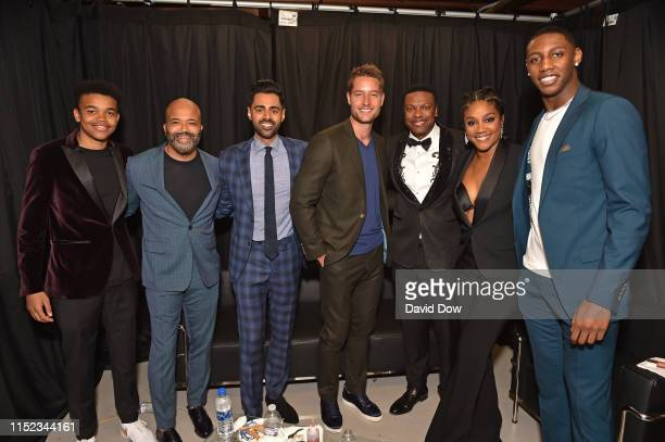 Elijah Wright Jeffrey Wright Hasan Minhaj Justin Hartley Chris Tucker Tiffany Haddish and RJ Barrett of the New York Knicks pose for a photo during...