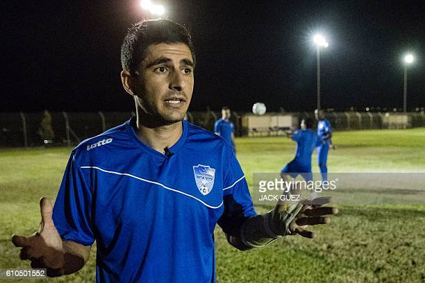 Eliko Ben Ayun Israeli defender and captain of the Aroni Ariel football club speaks to an AFP journalist during a training session at their stadium...