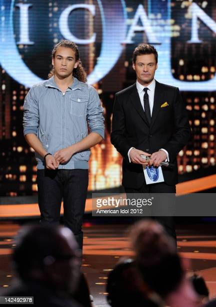 Eliminated contestant DeAndre Brackensick and host Ryan Seacrest performs onstage at FOX's 'American Idol' Season 11 Top 8 To 7 Live Elimination Show...