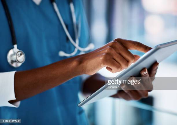 eliminating delays in patient care with digital technology - digital health stock pictures, royalty-free photos & images