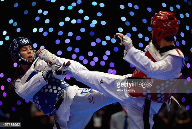 Elin Johansson of Sweden in action against Yun Fei Guo of China during the WTF World Taekwondo Grand Prix at Manchester Central on October 24 2014 in...