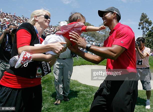 Elin Nordegren Woods passes daughter Sam to Tiger Woods after Tiger won the playoff round of the 108th U.S. Open at the Torrey Pines Golf Course on...