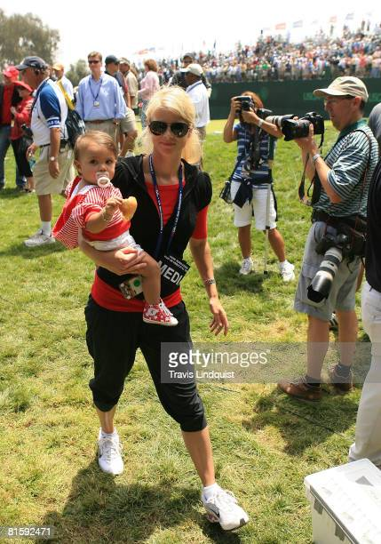 Elin Nordegren Woods walks with her daughter Sam after Tiger Woods won the playoff round of the 108th U.S. Open at the Torrey Pines Golf Course on...