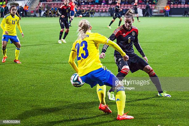 Elin Rubensson of Sweden challenges Simone Laudehr of Germany during the Women's international friendly between Sweden and Germany at Behrn Arena on...