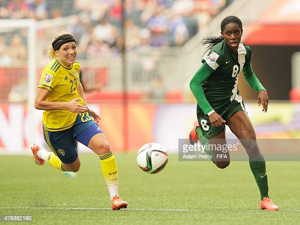 Elin Rubensson of Sweden chase down the ball with Asisat Oshoala of Nigeria during the FIFA Women's World Cup Canada 2015 Group D match between...