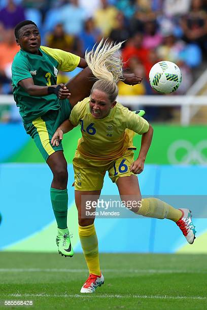 Elin Rubensson of Sweden collides with Nothando Vilakazi of South Africa during the Women's Group E first round match between Sweden and South Africa...