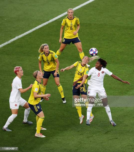 Elin Rubensson of Sweden competes for a header with Kadeisha Buchanan of Canada during the 2019 FIFA Women's World Cup France Round Of 16 match...