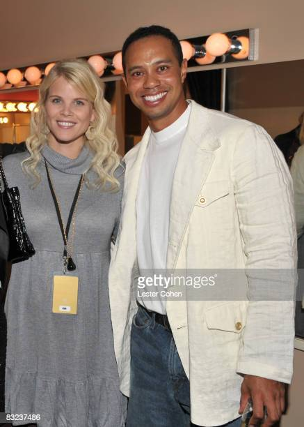 ANAHEIM CA OCTOBER 11 Elin Woods and Tiger Woods attends the Tiger Woods Block Party