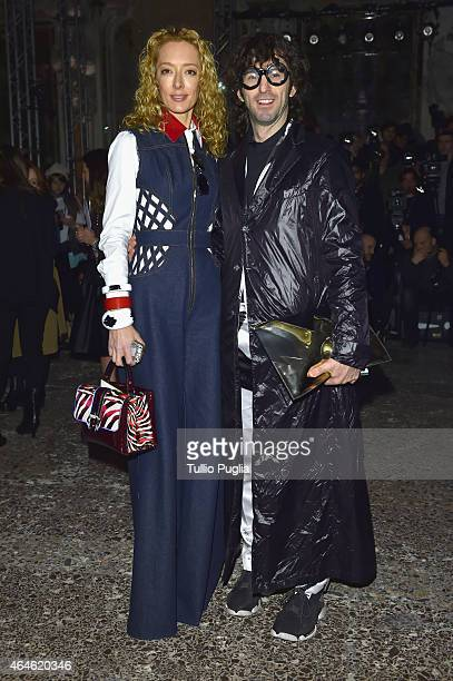Elina Halimi and Manos Samartzis attend the Uma Wang show during the Milan Fashion Week Autumn/Winter 2015 on February 27 2015 in Milan Italy