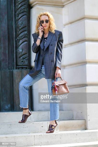 Elina Halimi attends the Balmain Menswear Spring/Summer 2018 show as part of Paris Fashion Week on June 24 2017 in Paris France
