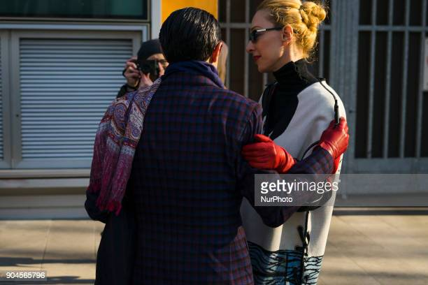 Elina Halimi is seen on the set of the Armani Advertising Campaign street style during Milan Men's Fashion Week Fall/Winter 2018/19 on January 13...