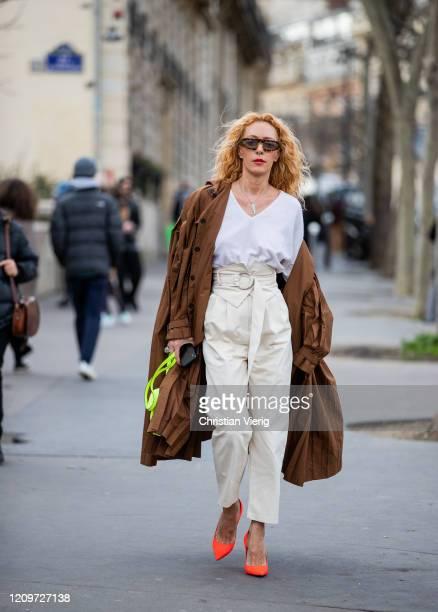 Elina Halimi is seen wearing brown coat, creme white pants outside Elie Saab during Paris Fashion Week - Womenswear Fall/Winter 2020/2021 : Day Six...