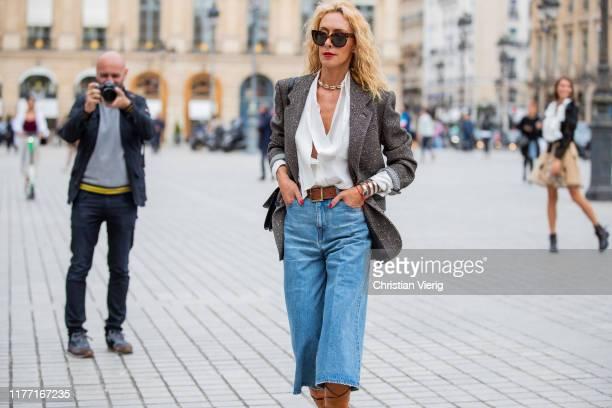 Elina Halimi is seen wearing denim jeans, brown boots, blazer outside Guy Laroche during Paris Fashion Week Womenswear Spring Summer 2020 on...
