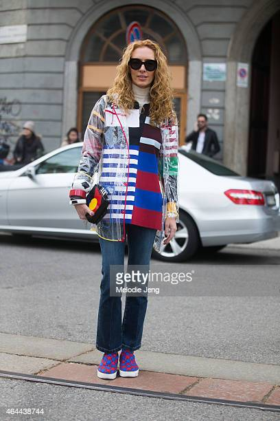 Elina Halimi of Kabuki Paris wears a Topshop jacket Stella McCartney top Celine shoes and a Le Petit Joueur bag on February 25 2015 in Milan Italy