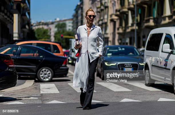 Elina Halimi outside Etro during the Milan Men's Fashion Week Spring/Summer 2017 on June 20 2016 in Milan Italy